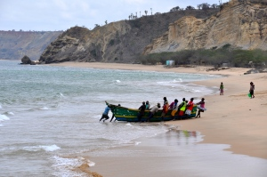 These old wooden boats must be heavy as lead.  Just look at how many men it took to get this boat onto the beach!
